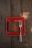 Chocolate brownie. With chocolate syrup on a wooden table Stock Photo