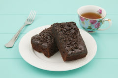 A chocolate brownie and a tea cup. Tea time Royalty Free Stock Images