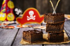 Chocolate brownie. Treats for children`s holiday. Pirate Party Royalty Free Stock Photos