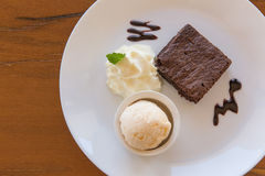 Chocolate brownie with vanilla ice cream, whipping cream served Royalty Free Stock Photography