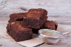 Chocolate brownie. On a wooden board, close-up Royalty Free Stock Image