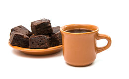 Chocolate brownies and cup of coffee Stock Images