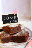Chocolate brownies dusted with icing sugar on plate Royalty Free Stock Photography