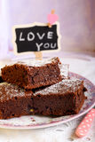 Chocolate brownies dusted with icing sugar Stock Photo