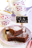 Chocolate brownies dusted with icing sugar Royalty Free Stock Images