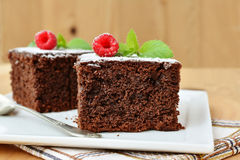 Chocolate brownies with fresh raspberry on white plate. Macro Royalty Free Stock Photography