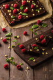 Chocolate brownies with mint. Raspberry and white chocolate Royalty Free Stock Photos