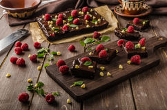 Chocolate brownies with mint. Raspberry and white chocolate Royalty Free Stock Photography