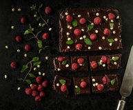 Chocolate brownies with mint. Raspberry and white chocolate Royalty Free Stock Image