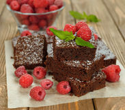 Chocolate brownies with raspberries Stock Photos