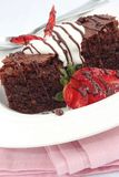 Chocolate brownies with strawberries and cream Royalty Free Stock Photography