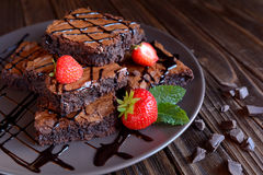 Chocolate brownies with strawberries royalty free stock photography