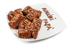Chocolate brownies on white plate Royalty Free Stock Image