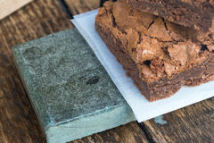 Chocolate Brownies & Wooden Table (2). Freshly Made Chocolate Brownies Presented on Wooden Table Stock Photos