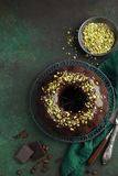 Chocolate bundt cake with chocolate glaze and pistachios. Top view Royalty Free Stock Photos