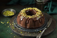 Chocolate bundt cake. With chocolate glaze and pistachios Stock Photography