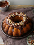Chocolate bundt cake with nuts. Food close-up Stock Photography