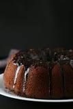 Chocolate bundt cake. On plate on black background Royalty Free Stock Image