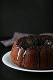 Chocolate bundt cake. On plate on black background Royalty Free Stock Photo