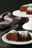 Chocolate bundt cake. On plate on black background Royalty Free Stock Photography