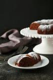 Chocolate bundt cake. On plate on black background Stock Photos