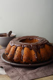 Chocolate bundt cake on plate. Food close-up Stock Images