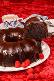 Chocolate bundt cake. On red velvet Royalty Free Stock Photo