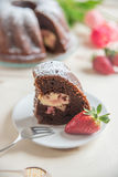 Chocolate bundt cake. With strawberry cheesecake filling Stock Photos