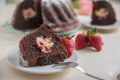 Chocolate bundt cake. With strawberry cheesecake filling Stock Image