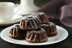Chocolate bundt cakes on plate on a black background Royalty Free Stock Photo