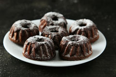 Chocolate bundt cakes on a plate on black background Stock Image