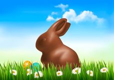 Chocolate bunny with easter eggs in grass. Royalty Free Stock Image