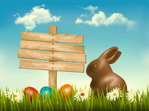 Chocolate bunny with easter eggs and a sign in a f Stock Image