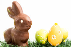 Chocolate bunny rabbit and three easter eggs Stock Image