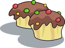 Chocolate Buns. Tasty chocolate buns with candy topping Royalty Free Stock Images