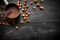 Chocolate butter with hazelnuts in a pan. Royalty Free Stock Images