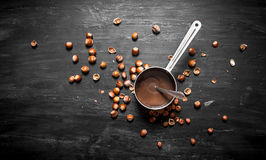 Chocolate butter with hazelnuts in a pan. Stock Image
