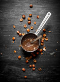 Chocolate butter with hazelnuts in a pan. Royalty Free Stock Photography