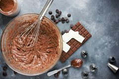 Chocolate buttercream frosting for cakes. Or chocolate ganache dessert royalty free stock image
