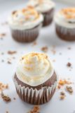 Chocolate Butterfinger Cupcakes. Chocolate cupcakes wirh a buttercream icing and crushed Butterfinger candy on top Stock Photo
