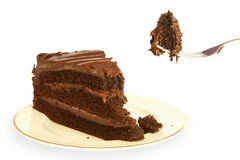 Chocolate cake. Slice of chocolate cake with a mouthful being lifted on a fork Royalty Free Stock Photo