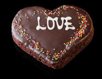 Chocolate Cake. In the shape of a heart  on a black background Stock Photos