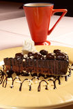 Chocolate cake. Decorated chocolate cake dessert served with coffee Royalty Free Stock Photo