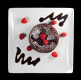 Chocolate cake. Chocolate rasberry molten cake on a white plate Stock Photos