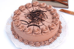 Chocolate cake. Delicious chocolate cake with cinnamon Royalty Free Stock Images