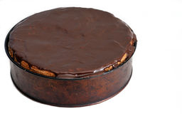 Chocolate cake. Big chocolate cake in form placed on the white background Royalty Free Stock Photography