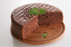 Chocolate cake. Without layers, with mint leaves, on white background Royalty Free Stock Photos
