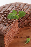 Chocolate cake. Without layers, with mint leaves, on white background Stock Photo