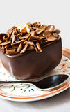 Chocolate cake. Chocholate cake in cup with spoon Royalty Free Stock Image