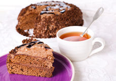 Chocolate Cake. A slice of chocolate cake with cup of tea Stock Photography